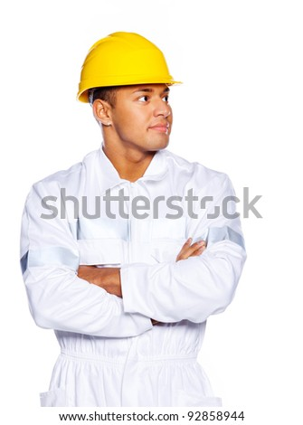 Image of young attractive worker with yellow hardhat