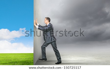 Image of young business man changing reality
