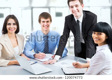 Image of young business people working at meeting