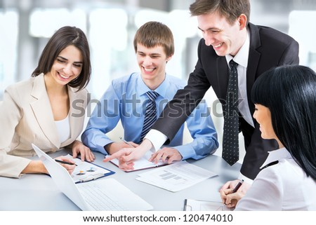 Image of young business people working at meeting - stock photo