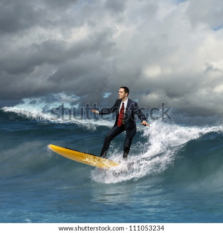 Image of young business person surfing on the waves of the ocean - stock photo