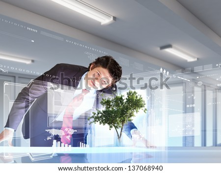Image of young businessman against high-tech picture of environment concept - stock photo