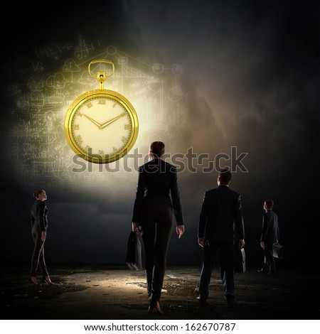 Image of young businessman and pocket watch. Time concept
