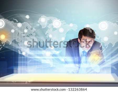 Image of young businessman clicking icon on high-tech picture - stock photo