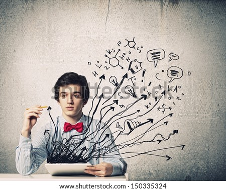 Image of young businessman holding tablet against sketch background - stock photo