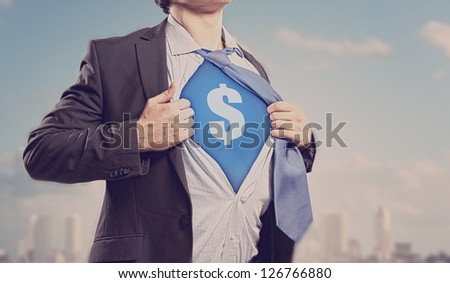 Image of young businessman in superhero suit with dollar sign on chest - stock photo