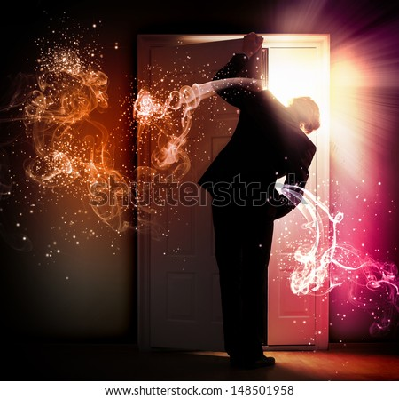 Image of young businessman standing with back opening door against smoke background - stock photo