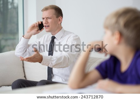 Image of young businessman working at home - stock photo