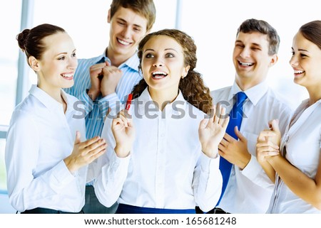 Image of young businesspeople congratulating colleague. Success concept - stock photo