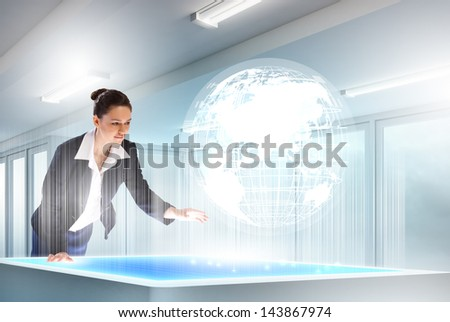 Image of young businesswoman clicking icon on high-tech picture - stock photo