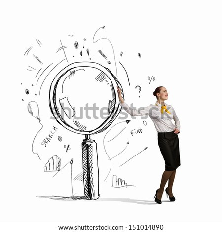 Image of young businesswoman leaning on magnifier - stock photo