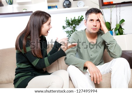 Image of young couple having quarrel - stock photo