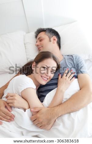Image of young couple waking up - stock photo