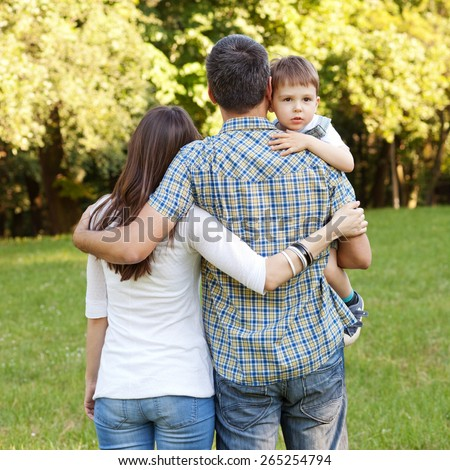 Image of young family taking a straw in the nature - stock photo