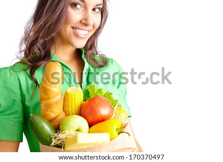 Image of young female holding paper sack full of different fruits and vegetables