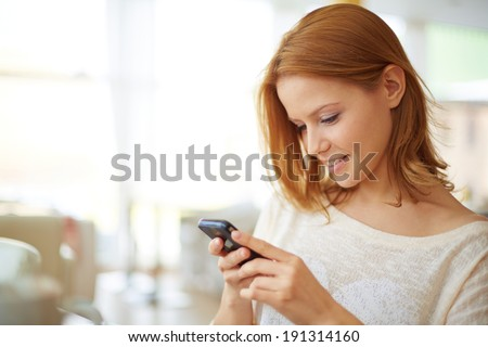 Image of young female using cellular phone