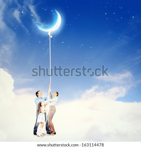 Image of young happy family pulling rope - stock photo