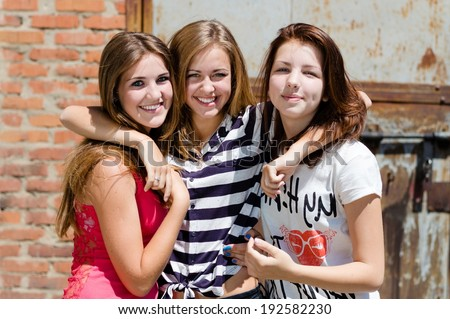 image of 3 young pretty female happy smiling teenage girl friends have fun in city outdoors portrait - stock photo