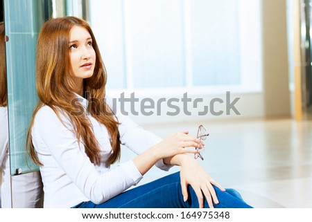 Image of young red hair woman in casual wear