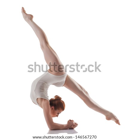 Image of young slender girl doing acrobatic stunt - stock photo