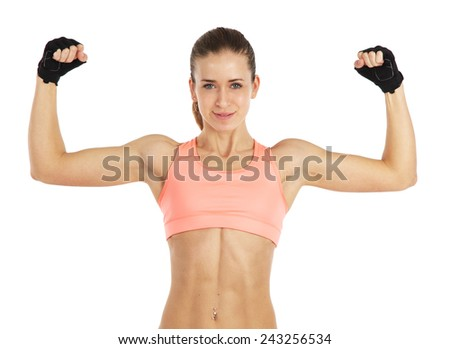 Image of young sporty woman showing her biceps isolated on white - stock photo
