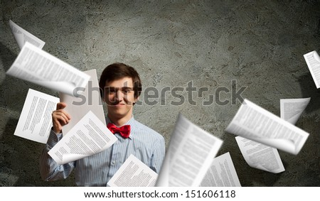 Image of young tired man holding folder with documents - stock photo