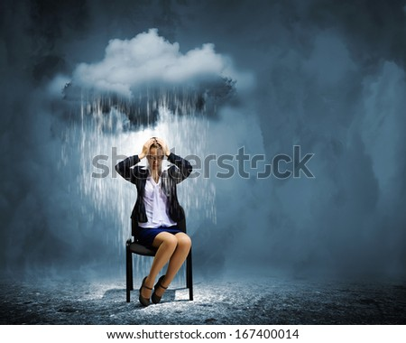 Image of young troubled businesswoman standing under rain