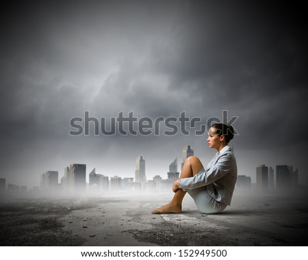 Image of young upset businesswoman sitting alone - stock photo