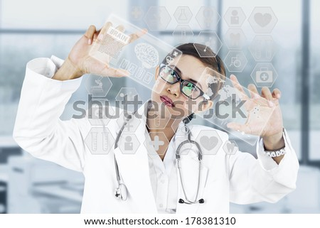 Image of young woman doctor. Concept of modern technology - stock photo