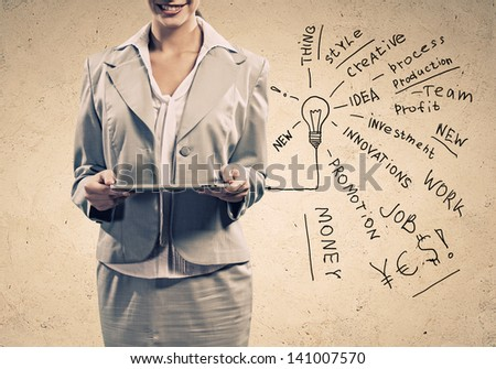 Image of young woman holding in hands tablet