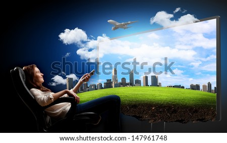 Image of young woman in armchair watching 3d tv - stock photo