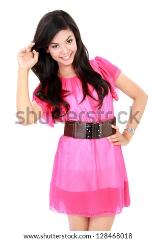 Image of young woman in pink dress smiling at camera isolated over white background