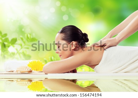Image of young woman relaxing in spa salon - stock photo