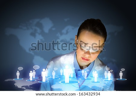 Image of young woman scientist in goggles against media screen. Net communication - stock photo