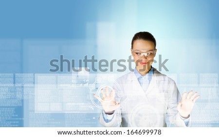 Image of young woman scientist touching icon of media screen - stock photo