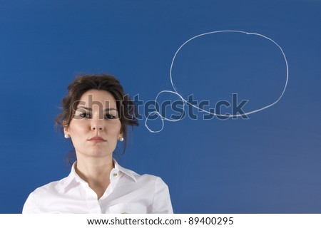 Image of young woman thinking on green board