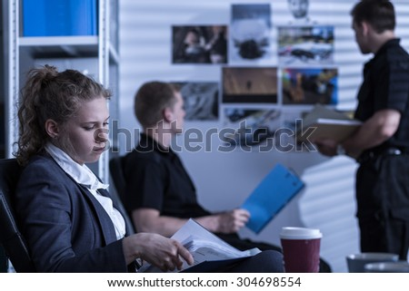 Image of young woman working in criminal investigation department - stock photo