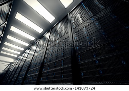 Image presents a bottom view of a room equipped with data servers. Blue LED lights are flashing. - stock photo