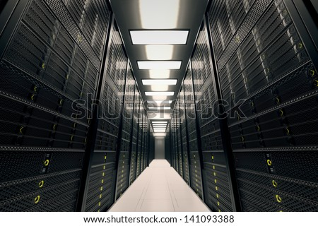Image presents a room equipped with data servers. Yellow LED lights are flashing. Image can represent cloud computing, information storage, etc. or can be the perfect technology background. - stock photo