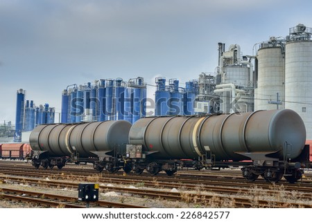 Image showing trains against an industrial background with factories pumping coal fumes into the atmosphere