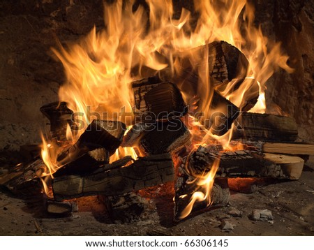 Image shows a fireplace close up - stock photo