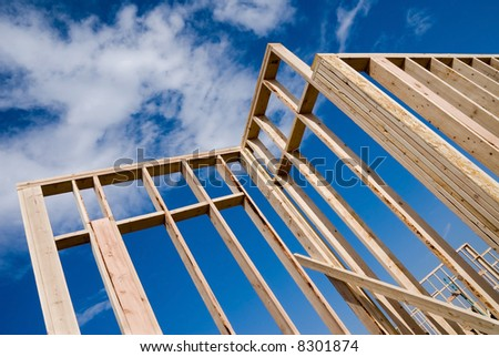 Image shows a home under construction at the framing phase.  Ideal for roofing advertising and other home construction promotional inferences. - stock photo