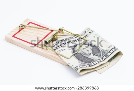 Image shows a mousetrap with a dollar bill on white background