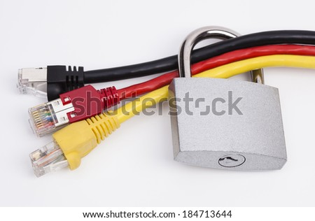 Image shows network cables in black, red and yellow with a lock - stock photo