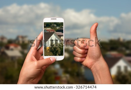 "Image smartphone photo of a beautiful house. The ""Like"" and the smart phone, taking pictures of the house. For Sale House."