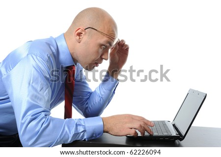 Image surprised businessman looking at computer monitor. Isolated on white background