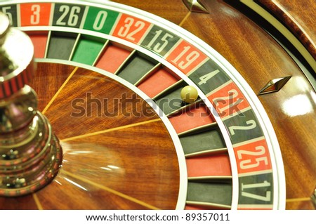 image with a casino roulette wheel with the ball on number 4 - stock photo
