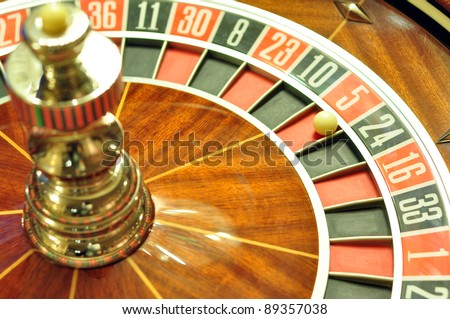 image with a casino roulette wheel with the ball on number 5 - stock photo