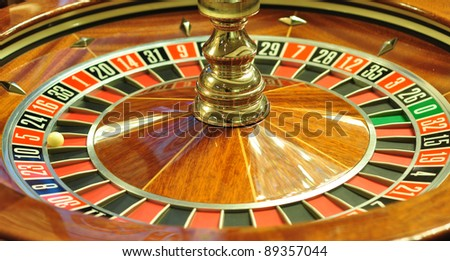 image with a casino roulette wheel with the ball on number 5