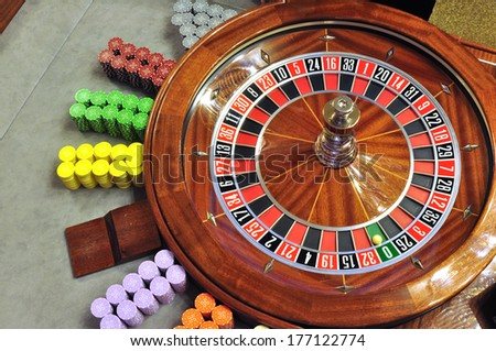 image with a casino roulette wheel with the ball on number zero - stock photo